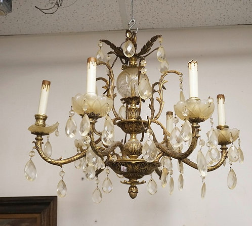 BRONZE CHANDELIER WITH CUT PRISMS. ONE BOBACHE IS DAMAGED. APPROX 19 INCHES LONG