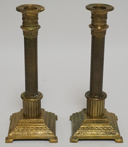 PAIR OF CAST BRASS CANDLESTICKS. ORNATELY TOOLED. 10 1/8 INCHES HIGH.