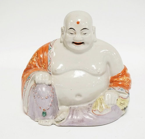 PORCELAIN BUDDHA FIGURE MEASURING 7 1/4 INCHES HIGH. CHARACTER MARK ON BOTTOM.