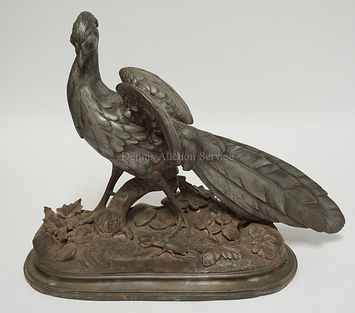 L. MAILLARD SPELTER SCULPTURE OF A LARGE BIRD WITH LEAVES AND A BEETLE BY HIS FE