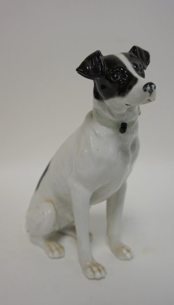 PORCELAIN SITTING DOG. HAS MAKERS MARK UNDER FRONT PAW.8 IN H