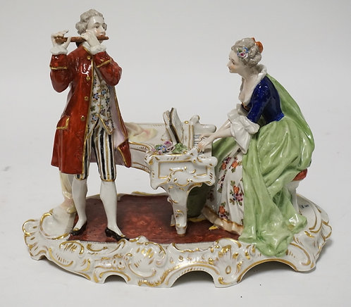 CAPODIMONTE PORCELAIN FIGURAL GROUP FEATURING A WOMAN PLAYING A PIANO AND A MAN