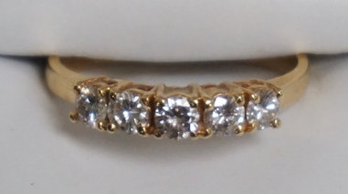 14K GOLD RING WITH 5 ROUND DIAMONDS. APPROX SIZE 9. 2.10 DWT.