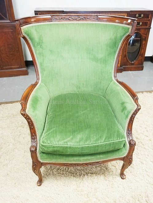 UPHOLSTERED CHAIR WITH A CARVED FRAME.40 INCHES HIGH.