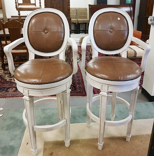 PAIR OF BAR STOOLSWITH LEATHER SEATS AND BACKS. 48 INCHES HIGH.