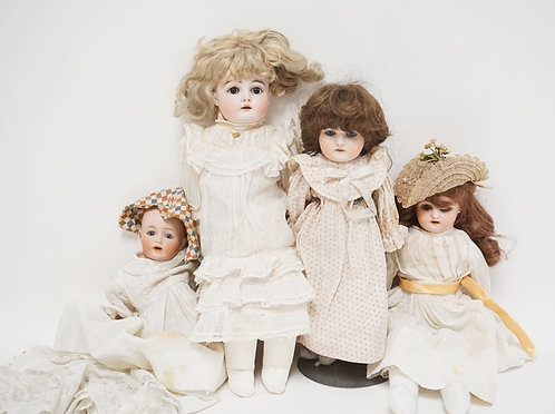 LOT OF 4 GERMAN BISQUE HEAD DOLLS. TALLEST IS 15 INCHES.