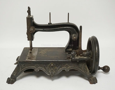 ANTIQUE CAST IRON SEWING MACHINE WITH PAW FEET AND SOME STENCIL DECORATION. #756
