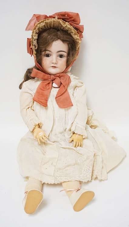 ANTIQUE BISQUE HEADED DOLL MEASURING 28 INCHES HIGH.