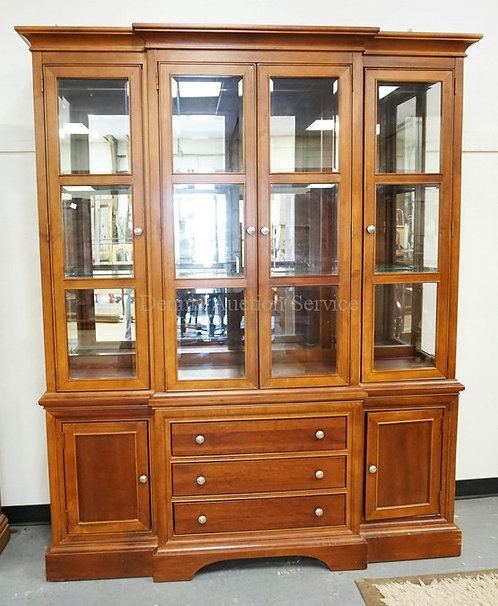 BLOCK FRONT CHINA CABINET WITH A LIGHTED INTERIOR, GLASS SHELVES, A MIRRORED BAC
