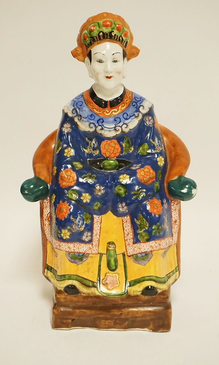ASIAN PORCELAIN FIGURE OF A SEATED MAN. 11 1/2 INCHES HIGH.
