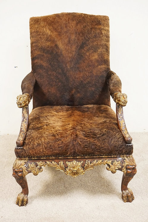 THEODORE ALEXANDER LARGE ARMCHAIR WITH BUFFALO FUR UPHOLSTERY, LION HEADS, AND H
