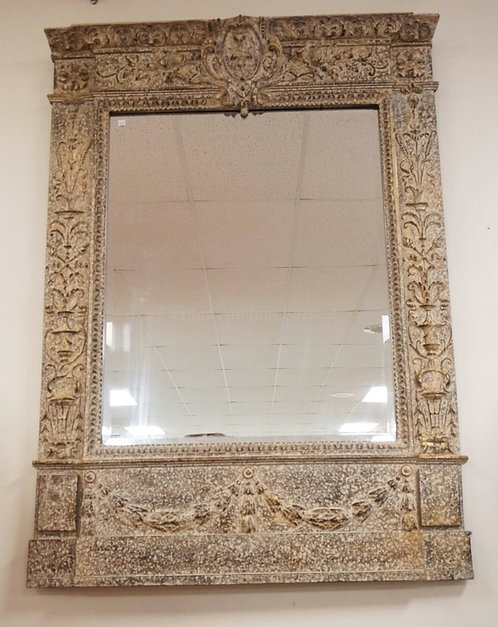 ORNATE MIRROR WITH BEVELED GLASS AND A MOTTLED FINISH. 43 X 59 1/2 INCHES.