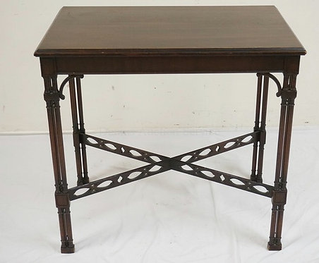 MAHOGANY LAMP TABLE WITH WITH TRIPLE COLUMN LEGS, AND A CUTWORK STRETCHER. 28 1/