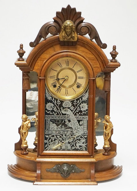ANSONIA *TRIUMPH* ORNATE VICTORIAN CLOCK FEATURING MIRRORED SIDES, METAL CHERUB
