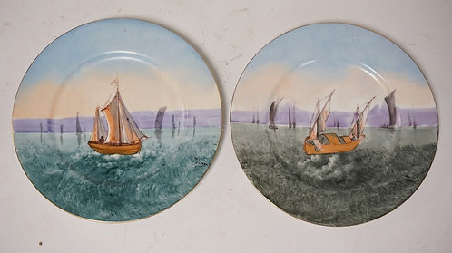 PAIR OF FRENCH LIMOGES PORCELAIN PLATES. HAND PAINTED WITH SAILBOATS. SIGNED *TH
