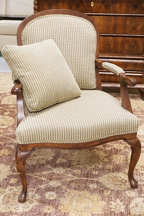 UPHOLSTERED ARMCHAIR WITH SCROLL CARVED ARMS.