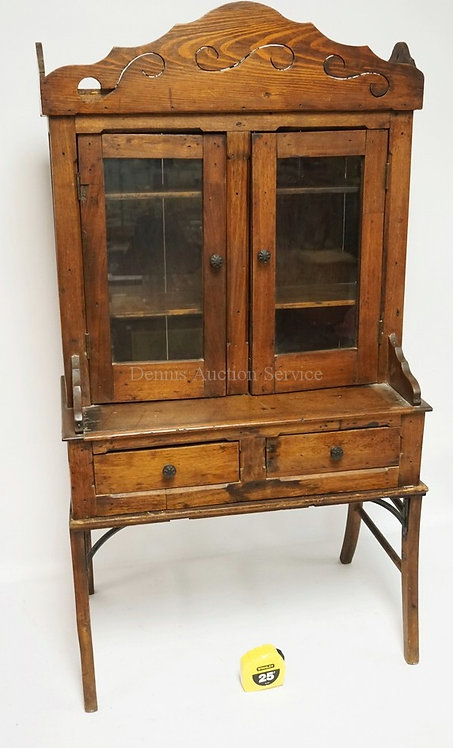 CHILD'S SIZE FOLK ART CABINET ON A BASE. 25 3/4 INCHES WIDE. 47 1/2 INCHES HIGH.