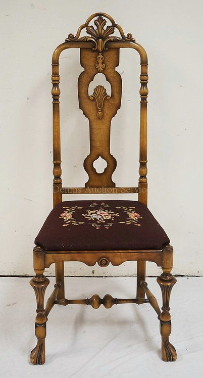 CARVED SIDE CHAIR WITH A NEEDLEPOINT SEAT OVER CANE (HAS SOME BREAKING).