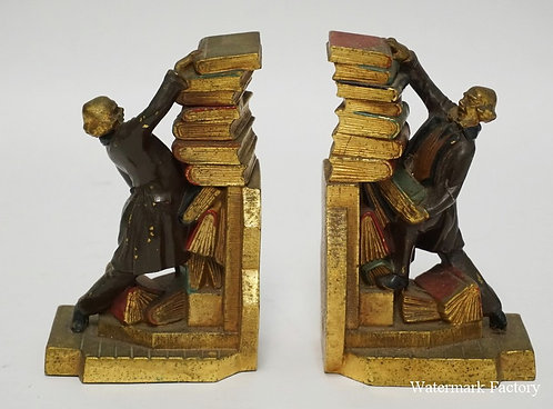 PAIR OF POLYCHROME DECORATED WHITE METAL BOOKENDS DEPICTING A MAN WITH A TUMBLIN