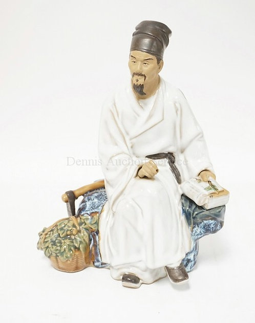 ASIAN FIGURE OF ASEATED MAN WITH A BOOK. 8 3/4 INCHES HIGH.