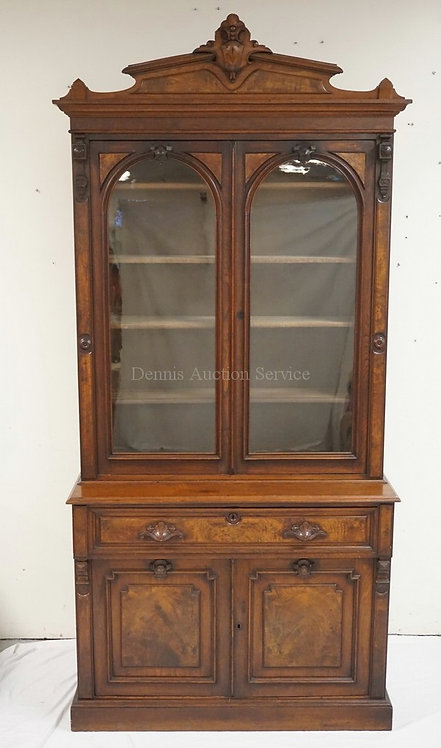CARVED VICTORIAN WALNUT DROP FRONT DESK WITH A BOOKCASE TOP HAVING 2 ARCHED GLAS