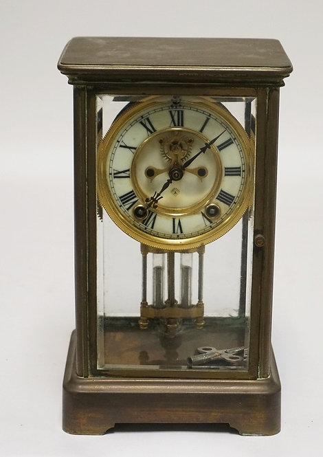 ANSONIA CRYSTAL REGULATOR CLOCK WITH A BRASS CASE. 10 3/4 INCHES HIGH. 6 1/2 INC