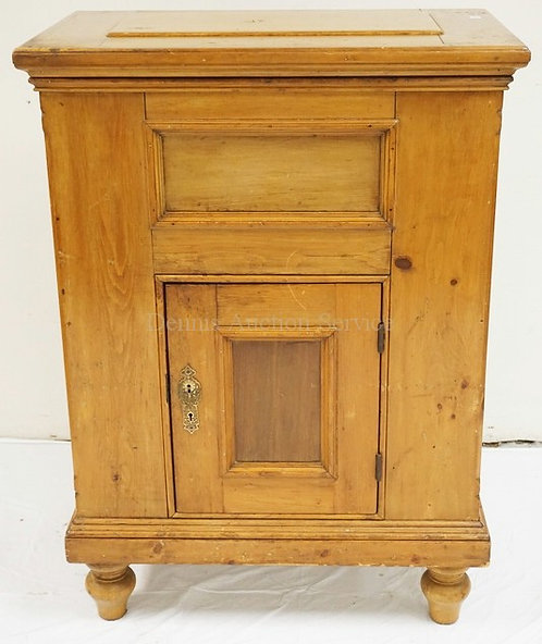 PINE ICE BOX WITH PANELED DOORS AND TURNED FEET. MEASURING 45 1/2 INCHES HIGH. 3
