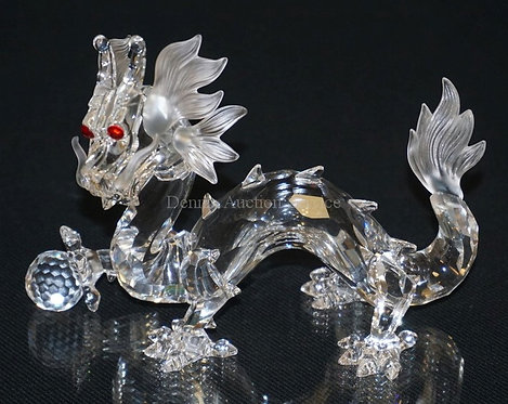 1013_SWAROVSKI CRYSTAL DRAGON WITH BOX AND CERTIFICATE. 3 3/4 INCHES HIGH.