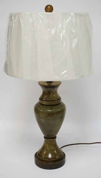 CARVED STONE TABLE LAMP MEASURING 27 INCHES HIGH.