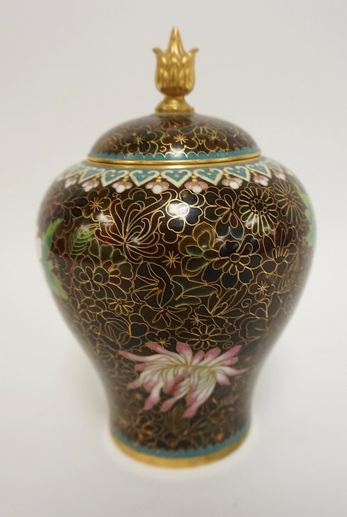 CLOISONNE COVERED JAR. PINK AND YELLOW FLOWERS ON A BLACK GROUND. 7 1/4 IN H
