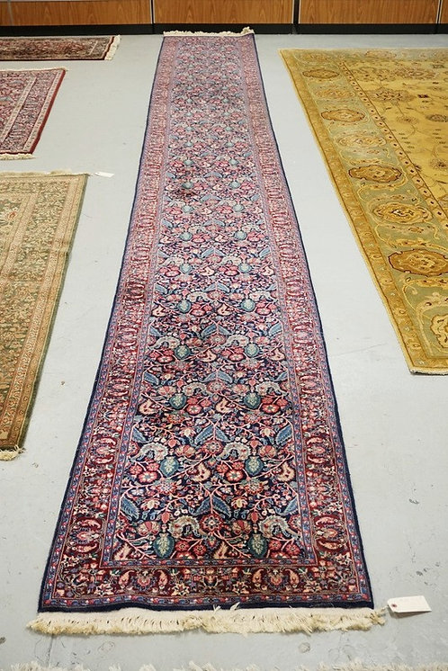 ORIENTAL RUNNER MEASURING 19 FT 10 INCHES X 2 FT 7 INCHES.