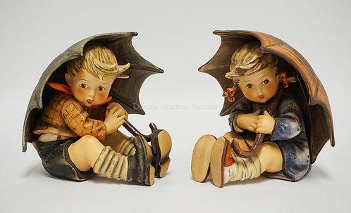 PAIR OF LARGE HUMMEL FIGURES. UMBRELLA BOY & GIRL. #152/II A & B. 7 1/2 INCHES H