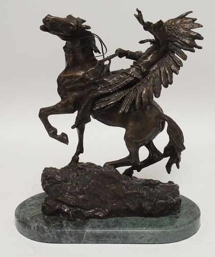 1009_BRONZE SCULPTURE OF A NATIVE AMERICAN INDIAN CHIEF ON HORSEBACK. 17 1/2 INC