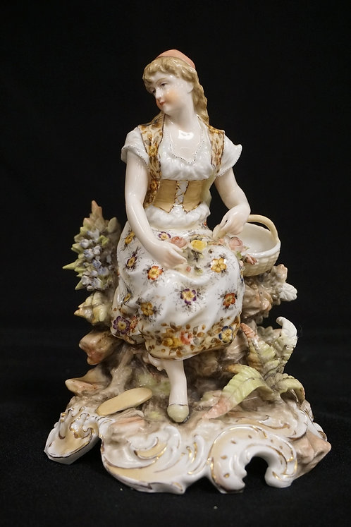 GERMAN PORCELAIN FIGURE OF A WOMAN. HAS A REPAIRED LEAF. SOME SMALL NICKS. 6 1/2