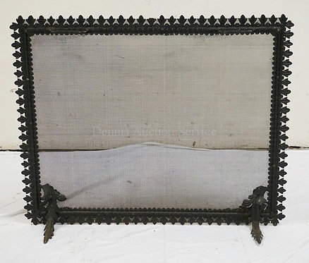IRON FIREPLACE SCREEN WITH ORNATE FEET. 28 1/2 INCHES HIGH. 25 INCHES HIGH.