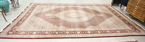 HAND WOVEN ORIENTAL RUG MEASURING 13 FT 6 INCHES X 9 FT 9 INCHES.