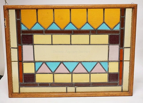 LEADED GLASS WINDOW IN AN OAK FRAME. FROM THE ESTATE OF JACK PALANCE 2006. 36 1/