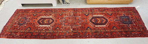 ANTIQUE ORIENTAL RUNNER MEASURING 11 FT X 3 FT 4 INCHES. HAS MOTH LOSSES AND REP