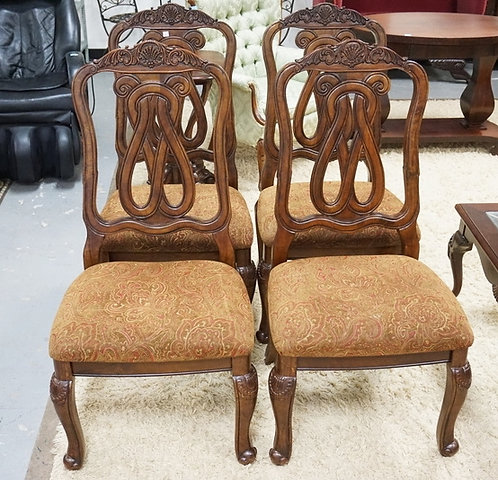 SET OF 4 CARVED DINING CHAIRS.
