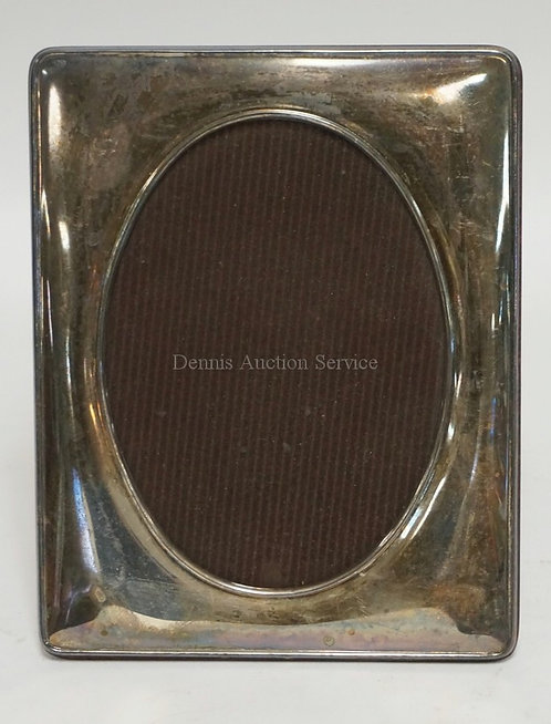 STERLING SILVER PICTURE FRAME MEASURING 7 X 9 INCHES.