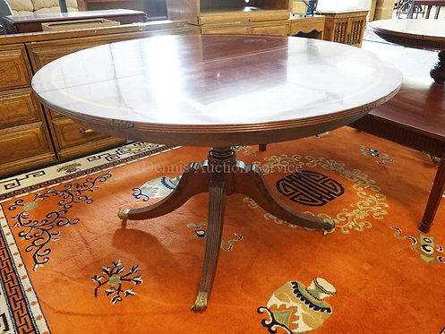 BANDED MAHOGANY ROUND TABLE WITH REEDED LEGS AND BRASS PAW FEET. 48 1/4 INCH DIA