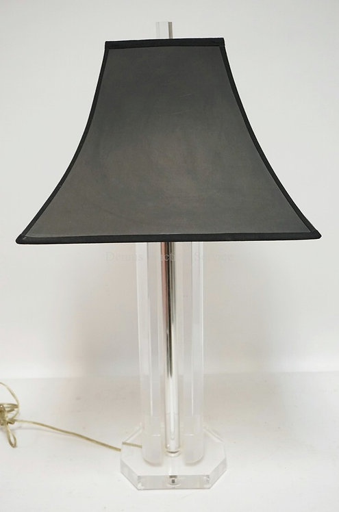 MODERN LUCITE TABLE LAMP WITH A BLACK SHADE. 29 INCHES HIGH.