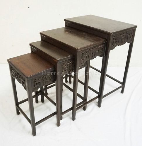 NEST OF 4 CARVED ASIAN TABLES. LARGEST MEASURES 20 1/2 INCHES WIDE AND 26 INCHES