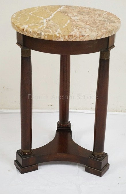 MARBLE TOP LAMP TABLE WITH COLUMN SUPPORTS. 16 1/2 INCH DIA. 25 INCHES HIGH.