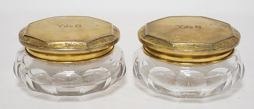 PAIR OF CUT GLASS POWDER JARS WITH GOLD WASHED STERLING SILVER LIDS. 2 7/8 IN H,
