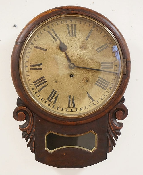 ANTIQUE FUSEE MOVEMENT DROP FRONT WALL CLOCK IN A CARVED CASE. 14 1/2 INCHES WID