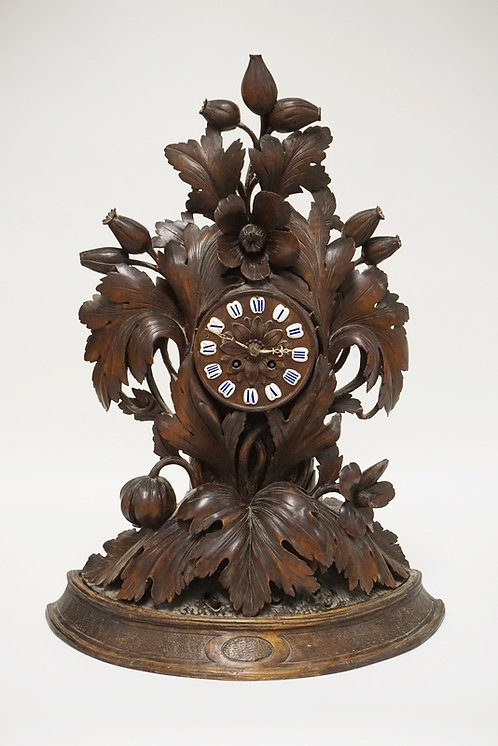 HEAVILY CARVED BLACK FOREST WALNUT CLOCK . HAS A FLOWER AND LEAF D�COR. 25 1/4 I