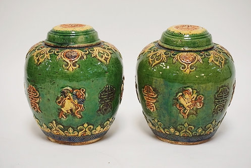 1102_PAIR OF ASIAN POTTERY LIDDED JARS. POLYCROME DECORATED. SOME CHIPS. ONE LID