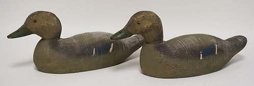 PAIR OF CARVED AND PAINTED WOODEN DECOYS MESURING 16 1/2 INCHES HIGH.