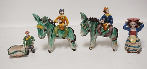 LOT OF 4 FIGURAL ITALIAN POTTERY FIGURES. TALLEST IS 5 1/4 INCHES.